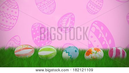 Colorful Easter eggs arranged side by side against pink background