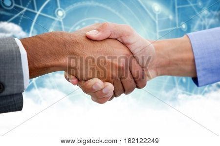 Male colleagues shaking hands against cloud computing