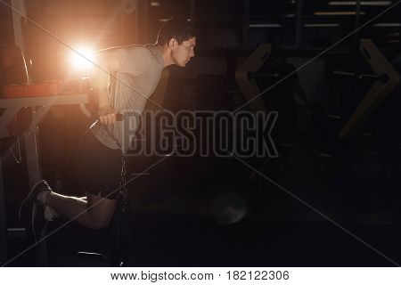 Muscular Bodybuilder Working Out In Gym Doing Exercises Parallel Bars. Concept Sport. Copy Space.