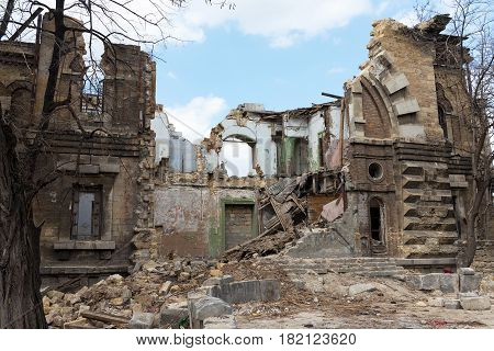 Landscape With An Abandoned, Collapsing Building In The City