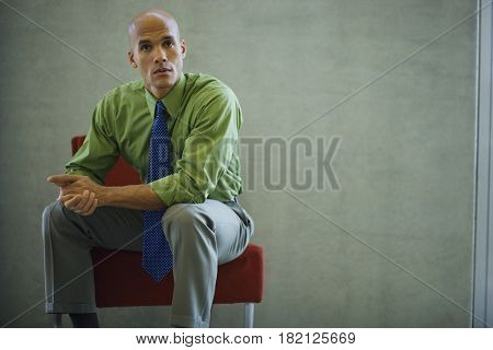 Mixed race businessman looking serious
