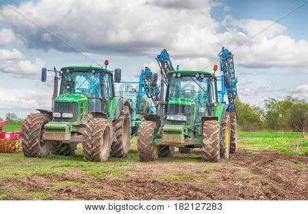 tractor spraying a field on farm. A close up