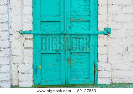 Close up obsolete cyan wooden window shutters