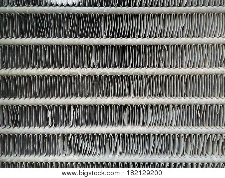 Car radiator honeycomb textured for background. Depth of field