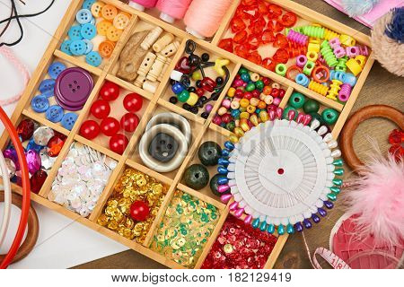 set of accessories and jewelry to embroidery, sewing accessories top view, seamstress workplace, many object for needlework, embroidery, handmade and handicraft