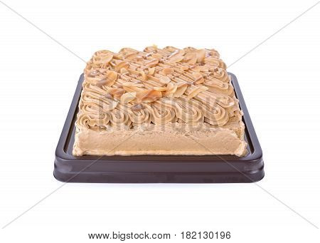 coffe cake with almond slice in plastic tray and on white background
