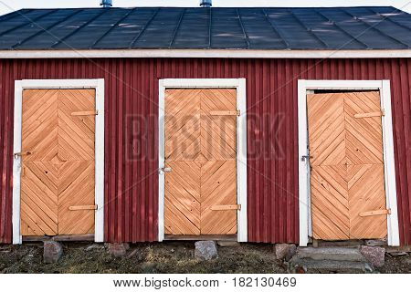 Three doors of an old wooden building at the fortress area in Lappeenranta Finland. The area is full of old buildings and details like this.