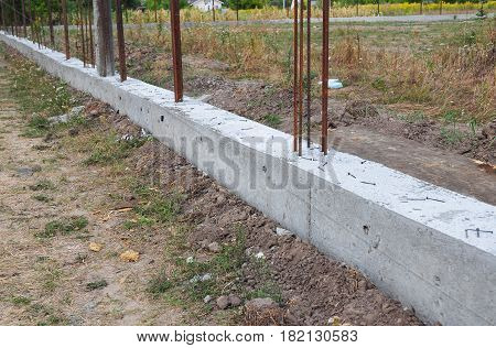 Building concrete foundation for metal fence. Foundation for Fencing.