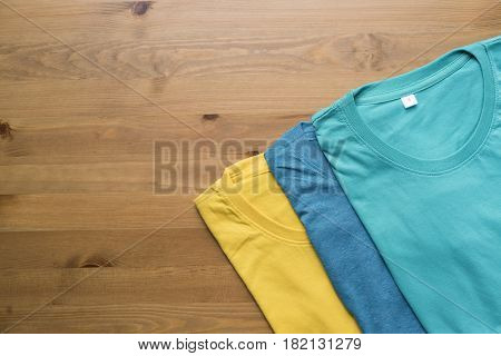 Top view of color t-Shirt on black background