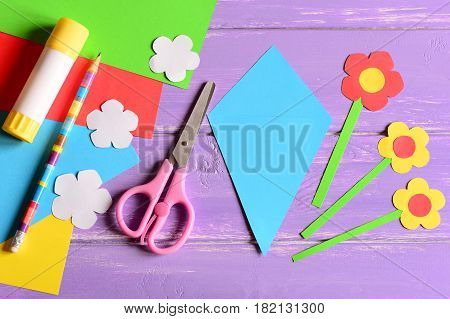 Creating paper crafts for mother's day or birthday. Step. Guide. Details to making a paper bouquet for mommy. Scissors, glue stick, flowers templates, pencil on a table. Kids art activity. Top view