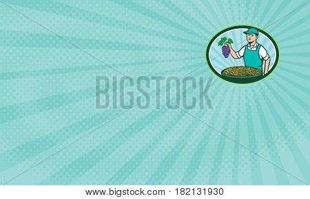 Business card showing Illustration of a farm boy wearing hat holding grapes with bowl of raisins set inside oval shape with sunburst in the background done in retro style.