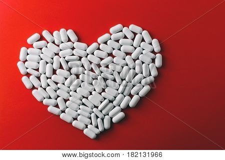 Heart Made Of White Pills On Red Background, Heart Disease Medications