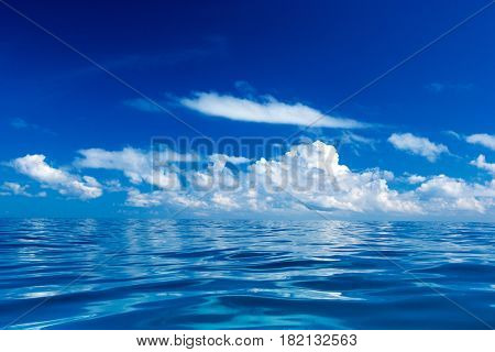 sea surface summer wave background. water landscape with clouds on horizon. Natural tropical water paradise. Ocean nature tranquility