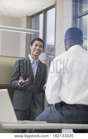Multi-ethnic businessmen meeting in office