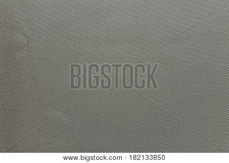 the textured background of fabric or textile material of pale or faded color