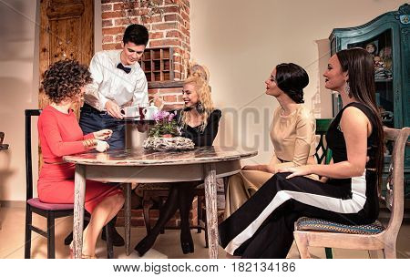 youth which is cheerfully spending time in cafe