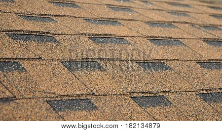 Asphalt Shingles Soft Focus Photo. Close up view on Asphalt Roofing Shingles Background. Roof Shingles - Roofing Construction Roofing Repair.