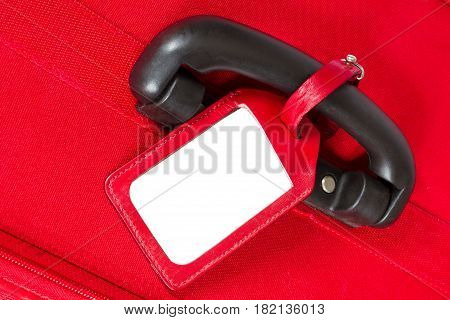 Suitcase Tag on Handle Empty Travel Luggage Label Red Baggage Bag Closeup