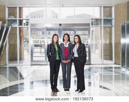 Businesswomen posing in lobby