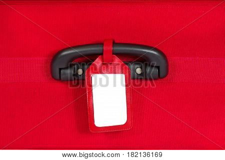 Suitcase Tag Empty Travel Luggage Label on Handle Red Baggage Bag Close up
