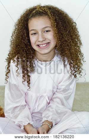 Mixed race girl in nightgown