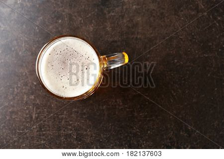 Mug with beer on table