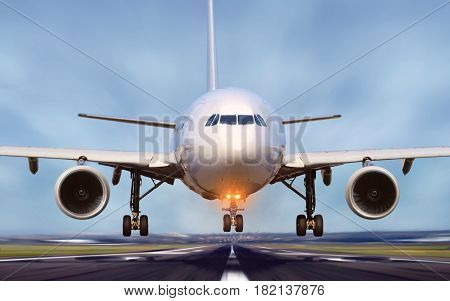 Airplane taking off from airport runway with motion blur