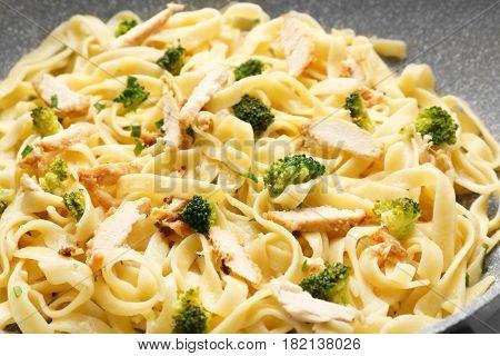 Tasty Italian chicken Alfredo, closeup