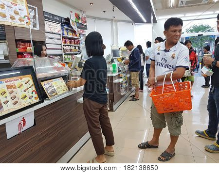 BANGKOK THAILAND - MARCH 31 : unidentified people paying at the cashier in 7- Eleven on March 31 2017 in Bangkok Thailand.