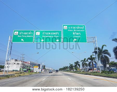 KAMPHAENG PHET THAILAND - MARCH 31 : directional traffic sign to Phichit and Ban Pang Makha on March 31 2017 in Kamphaeng Phet Thailand.