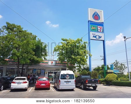 NAKHON SAWAN THAILAND - MARCH 31 : PTT gas station sign with 7-Eleven in blue sky backgound on March 31 2017 in Nakhon Sawan Thailand.