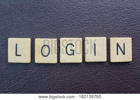 Login word - entry to website on internet - ovehead photo of wood blocks spelling login