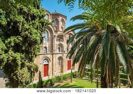 View of green garden and Church of Panagia Chalkeon in Thessaloniki. Greece Europe