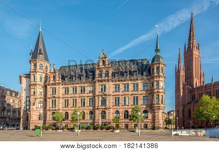 WIESBADEN, GERMANY - APRIL 10,2017 - City hall with Bell tower of Markt church in Wiesbaden. Wiesbaden is one of the oldest spa towns in Europe.