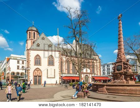 FRANKFURT AM MAIN, GERMANY - MARCH 30,2017 - Liebfrauen church with fountain in Frankfurt am Main. Frankfurt is the major financial centre of the European continent.