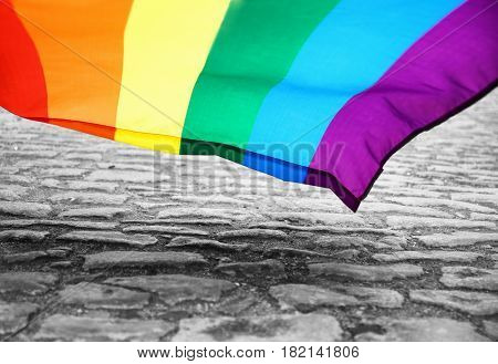 Gay flag over paving blocks