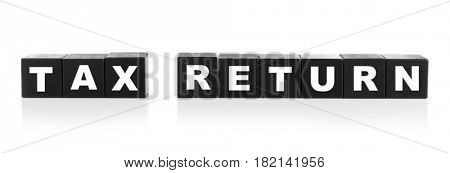Wooden cubes with text TAX RETURN on white background