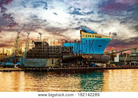 View of the quay shipyard at sunrise in Gdansk Poland.