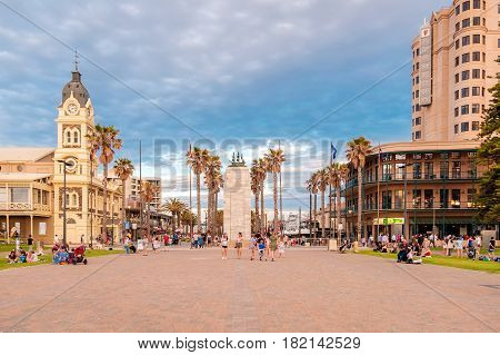 Adelaide Australia - August 29 2016: People walking at Moseley Square with Pioneer Memorial in the middle at sunset. Moseley Square is very popular among tourists and locals and located at the end of Jetty Road in Glenelg.