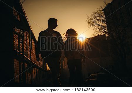 Amazing Silhouette Of Lovers. True Love Emotions Of Joyful Cute Couple Enjoying Time Together Outdoo