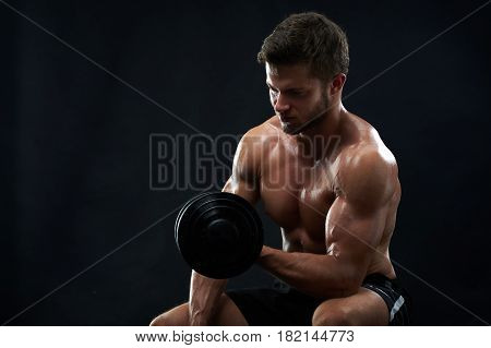 Studio shot of a fit muscular young man exercising with dumbbell shirtless on black background copyspace fitness gym sport sportsman athlete sexy hot body care health motivation effort achievement.