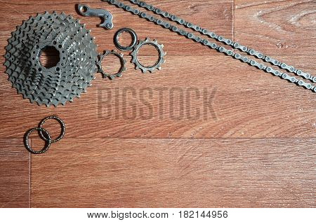 Some Composition Of A Bicycle Chain, Several Sprockets And Other Components Of A Sports Bike