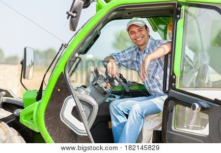 Portrait of a smiling farmer in his tractor