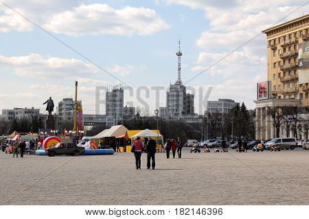 KHARKOV, UKRAINE - APRIL 21, 2011: This is the Liberty Square with the building of the State Industry built in the style of constructivism of the 30s of the 20th century.