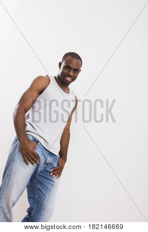 African man in jeans and tank top