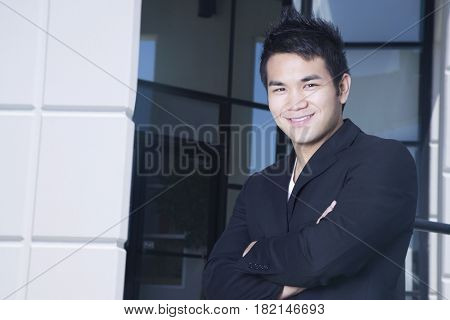 Asian businessman outside office building