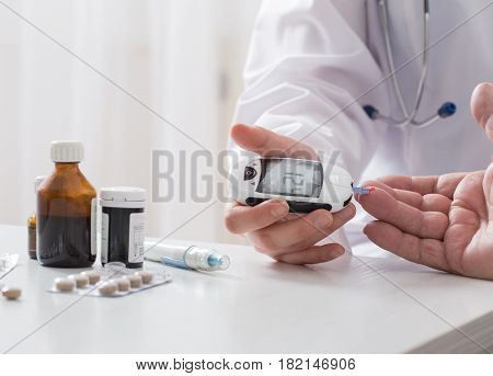 the doctor measuring blood sugar on white background