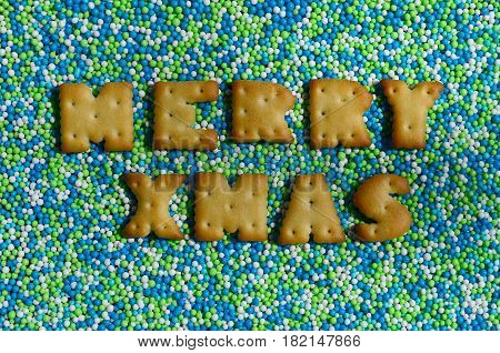 Merry Xmas. The Word From The Edible Letters Lies On The Glazed Powder