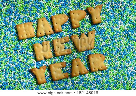 Happy New Year. The Word From The Edible Letters Lies On The Glazed Powder