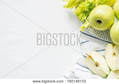 Fresh Green Apples And Celery On White Cloth Background. Healthy Ingredients For Smoothie. Top View